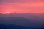The sun sets beyond the Garnet Mountains on a summer night in Montana