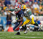 5 November 2006: Buffalo Bills wide receiver Roscoe Parrish (11) returns a punt for 17 yards as Green Bay tight end Donald Lee (86) makes the tackle at the Green Bay 38 yard line in the fourth quarter at Ralph Wilson Stadium in Orchard Park, NY. The Bills defeated the Packers 24-10. Mandatory Photo Credit: Ed Wolfstein Photo.<br />