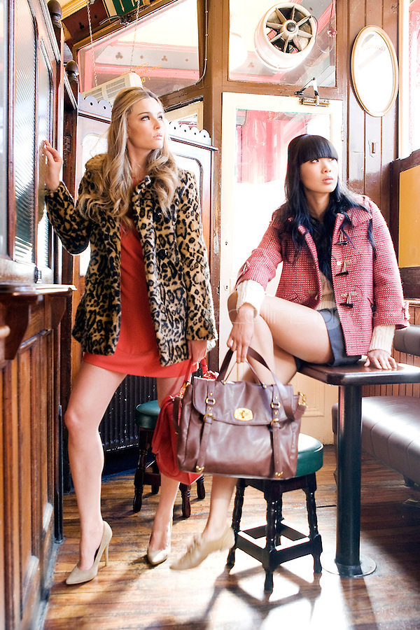 NO REPRO FEE.30/8/2010. AWEAR AUTUMN COLLECTION. Yomiko Chen & Sarah Morrissey model a selection of dresses from A|wear's new autumn '10 collection at Kehoes Pub in Dublin. Sarah wears Leopard Print Swing Coat - EUR70 Tamarind Bow Shift Dress - EUR45 - EUR35 .Yomiko Chen wears Red woven duffle coat - EUR60 Side tie shorts - EUR30 Aran knit jumper - EUR35  The collection arrives instore and onwww.awear.com from this week.  Picture James Horan/Collins Photos