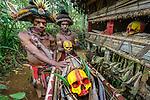 Huli wigmen with painted skulls, Papua New Guinea
