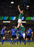 Devin Toner of Ireland rises high to win lineout ball. Rugby World Cup Pool D match between France and Ireland on October 11, 2015 at the Millennium Stadium in Cardiff, Wales. Photo by: Patrick Khachfe / Onside Images