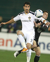 Mark Burch (4) of D.C. United  pushes into the back of Juan Pablo Angel (9) of the Los Angeles Galaxy during an MLS match at RFK Stadium, on April 9 2011, in Washington D.C.The game ended in a 1-1 tie.