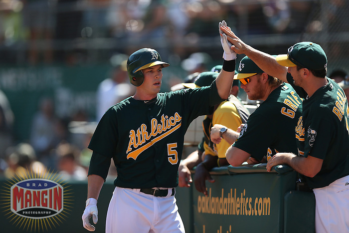OAKLAND, CA - SEPTEMBER 30:  Stephen Drew #5 of the Oakland Athletics celebrates with his teammates during the game against the Seattle Mariners at O.co Coliseum on Sunday, September 30, 2012 in Oakland, California. Photo by Brad Mangin