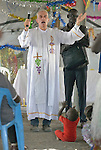 Father Mike Bassano, a Maryknoll priest from the United States, gestures as he preaches during mass in a makeshift chapel inside a United Nations base in Malakal, South Sudan. More than 20,000 civilians have lived inside the base since shortly after the country's civil war broke out in December, 2013, and renewed fighting in 2015 drove an additional 5,000 people into the relative safety of the camp. Bassano lives in the camp to accompany the people there.