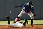 """Major League Baseball prospect Franklin Guzman is tagged out during the final game of the """"Torneo Supremo"""" at the Quiskeya National Stadium in Santo Domingo. The Tournament which aims to maximize the ability of Major League Baseball organizations to scout in the Dominican Republic. According to the MLB's office in the Dominican Republic, this year, the tournament introduced 23 new baseball prospects. July 29 2011. ViewPress/ Kena Betancur"""