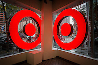 Customers enter and leave the new Target smaller store in the Tribeca neighborhood in New York on Saturday, October 8, 2016. In order to boost stagnant sales growth Target is opening smaller urban stores with 20 open already and 14 more expected to open in 2016. (© Richard B. Levine)