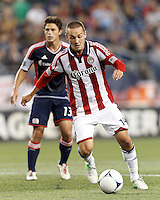 Chivas USA forward Casey Townsend (14) on the attack. In a Major League Soccer (MLS) match, the New England Revolution tied Chivas USA, 3-3, at Gillette Stadium on August 29, 2012.