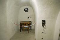 Roma 25 Ottobre 2014<br /> Aperti al pubblico i bunker segreti, costruiti tra il 1942 e il 1943,dove Benito  Mussolini e la sua famiglia cercava rifugio dai bombardamenti degli alleati nella residenza privata di Villa Torlonia. Nella foto: Il rifugio cantina, il prima ambiente adibito a rifugio antiaereo, attrezzato  intorno alla met&agrave; del 1940,  fu dotato di doppie porte blindate e di ,un sistema antigas di filtraggio, e rigenerazione dell&rsquo;aria, che veniva azionato a manovella,  un gabinetto, un telefono con linea diretta ad uso di Mussolini. La scrivania messa a disposizione di Mussolini<br /> Open to the public the secret bunkers built between 1942 and 1943, where Benito Mussolini and his family sought refuge from Allied bombing in the private residence of Villa Torlonia. <br /> Pictured: The cellar shelter,  the first air-raid shelter,built around the middle of 1940, was equipped with double doors armored  and a gas filtering system and regeneration air , that was operated crank, a toilet, a direct dial telephone for use by Mussolini. The desk  to provision of Mussolini