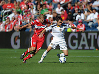 Chicago defender Steven Kinney (28) pressures LA Galaxy midfielder Dema Kovalenko (21).  The LA Galaxy tied the Chicago Fire 1-1 at Toyota Park in Bridgeview, IL on September 4, 2010