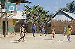 Young Kuna boys play basketball on Rio Sidra, San Blas Islands, Kuna Yala, Panama