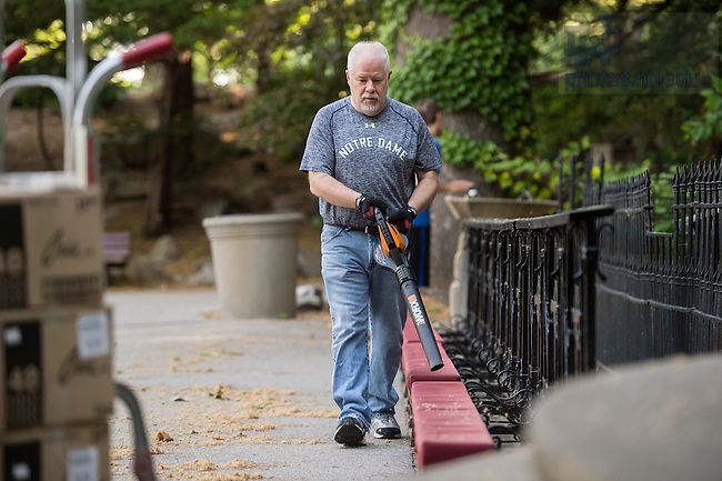 June 12, 2016; Tim Malott, Grotto caretaker, uses a leaf blower to clean up cobwebs and tree debris around the Grotto.  He says he pauses when visitors stop by for prayer. (Photo by Matt Cashore/University of Notre Dame)