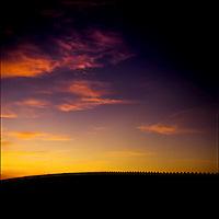 The sun sets at the Mexico border near San Diego, Southern California.