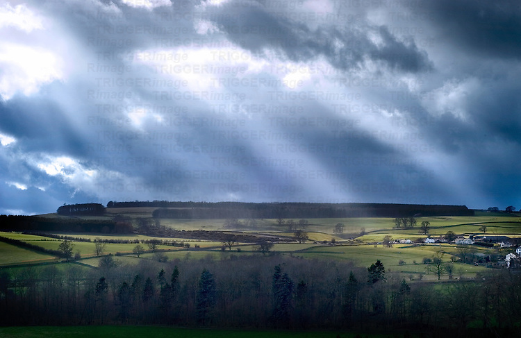 Dark clouds with sun rays over moors in England