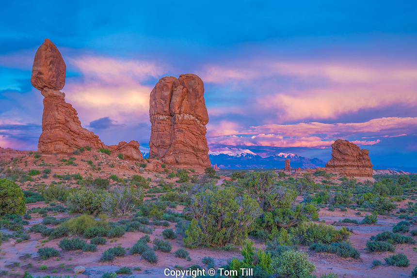 Balanced Rock and sunset clouds, Arches National Park, Utah, La Sal Mountains beyond