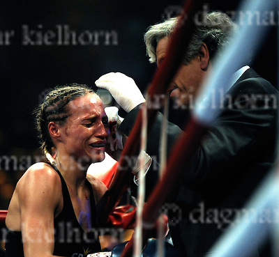 Saturday,January 09-10,Boerderlandhalle,Magdeburg,Germany.WBC female featherweight title.WIBF Women's International Boxing Federation featherweight title.WBO female featherweight title<br /> Ina Menzer,Germany vs Ramona Kuehne<br /> Ring physician Christoph G&ouml;tz from Hamburg looks at a deep cut under Ramona`s left eye.He decides to stop the fight.Ramona breaks out in tears.