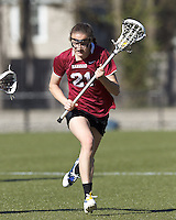 Harvard University midfielder Audrey Todd (21) brings the ball forward.
