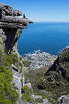 CAPE TOWN, SOUTH AFRICA FEBRUARY 28: Hiking expert Tim Landy sits on the top of Kasteel Port with a view of Camps Bay and The Atlantic ocean on February 28, 2016 in Cape Town, South Africa. The city offers many different hiking trails close to the city center. The Pipe track to Kasteel port is one of the most challenging hikes in Cape Town. (Photo by: Per-Anders Pettersson)