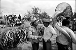 Zapotec Native friends talk each other as they attend the wedding ceremony of their relatives in Coatecas Altas village, Oaxaca, November 22, 1998. Most of the villagers of Coatecas leave their home to harvest in northern state of Sinaloa.  © Photo by Heriberto Rodriguez