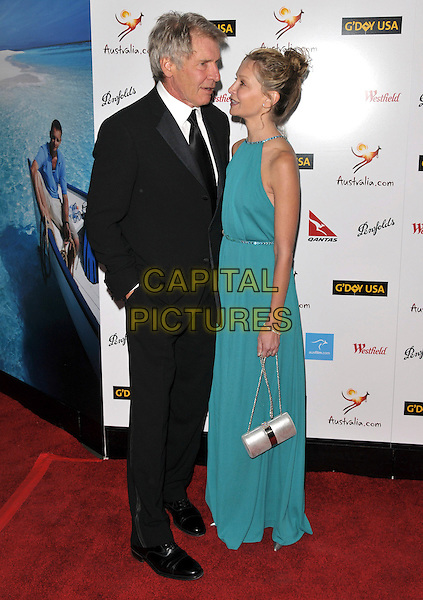 HARRISON FORD & CALISTA FLOCKHART .Attends The Annual G'Day USA Australia.com Black Tie Gala held at Hollywood & Highland Ballroom in Hollywood, California, USA, January 19th 2008.                                                                                       full length turquoise green dress silver bag black suit tie couple.CAP/DVS.©Debbie VanStory/Capital Pictures