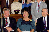 """Washington, DC -- March 6, 1990 -- United States Senator Edward M. """"Ted"""" Kennedy (Democrat of Massachusetts), left, and U.S. Senator Orrin Hatch (Republican of Utah), right, attend a Capitol Hill press conference with Actress Elizabeth Taylor, center, concerning some AIDS legislation on March 6, 1990..Credit: Howard L. Sachs / CNP"""