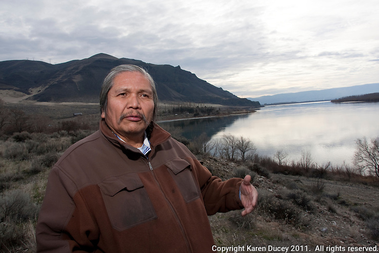 "Rex Buck Jr., leader of the Wanapum Indians, walks along the banks of the Columbia River just south of the Wanapum Dam on February 3, 2011.  ""The river flows in us and we're a part of the river and we're also a part of this land.""  said Buck.  The Wanapum Indians had never moved onto a reservation but negotiated peacefully with a power company to remain on their land.  (photo credit Karen Ducey)"