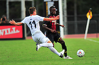 Pierre Reedy of Penn State tries to clear the ball against Terrapins Suli Dainkeh. Maryland defeated Penn State in over time 3-2 during an NCAA D-1 soccer match at Ludwig Field in College Park, MD on Sunday, September 18, 2016.  Alan P. Santos/DC Sports Box