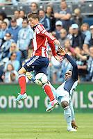 Chivas Jorge Villafana (19) midfield USA tackled by Mechack Jerome (24) defender Sporting KC ..Sporting Kansas City defeated Chivas USA 4-0 at Sporting Park, Kansas City, Kansas.