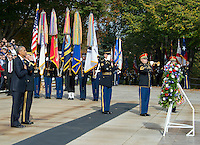 United States President Barack Obama, left, and US Army Major General Bradley A. Becker, Commander, US Army Military District of Washington, left center, stand at attention as a bugler blows &quot;Taps&quot; during a wreath-laying ceremony at the Tomb of the Unknown Soldier at Arlington National Cemetery in Arlington, Virginia on Veteran's Day, Friday, November 11, 2016.<br /> Credit: Ron Sachs / Pool via CNP /MediaPunch