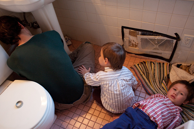 """My husband is always surrounded by repair jobs and enthusiastic """"helpers."""" Here the two-year-old and the five-year-old, who was sick but didn't want to miss out on the activity, assist with the bathroom sink."""
