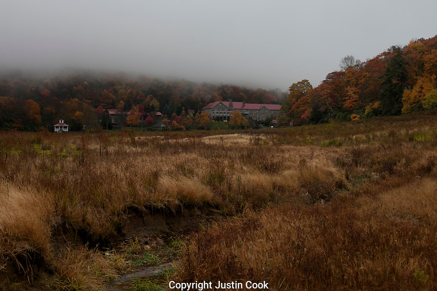 Mountain Lake Resort and Conservancy from the empty lake bed, in the fog on a fall day, Giles County, Virginia.