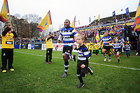 Semesa Rokoduguni of Bath Rugby, mascot in hand, runs out onto the field. Aviva Premiership match, between Bath Rugby and Saracens on December 3, 2016 at the Recreation Ground in Bath, England. Photo by: Patrick Khachfe / Onside Images