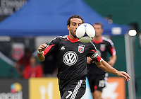 WASHINGTON, D.C. - AUGUST 19, 2012:  Dwayne DeRosario (7) of DC United pulls in a high ball against  the Philadelphia Union during an MLS match at RFK Stadium, in Washington DC, on August 19. The game ended in a 1-1 tie.