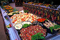 A huge banquet table is laden with seafood for a luau at the Kona Village Resort on the Big Island of Hawaii.