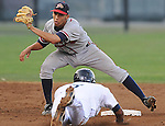 Andrelton Simmons (5) of the Danville Braves puts the tag on Jorge Aguedlo (7) of the Pulaski Mariners, who was attempting to steal in a game on July 19, 2010, at Calfee Park in Pulaski, Va. Photo by: Tom Priddy/Four Seam Images
