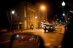 A police car on patrol through downtown on Georgia St., in Vallejo, Ca., Friday, April 8, 2011. The city's sole police station is closed to the public four days out of the week, and the three substations are permanently shuttered. The City of Vallejo filed for bankruptcy in 2008, and the city is still suffering but budget cutbacks, including seniors.