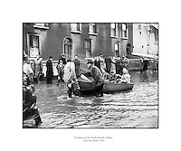 Flooding at the North Strand, Dublin.8-12/12/1954..From The Irish Times - December 12 2005..SEVERE storms during this week in 1954 brought some of the worst flooding ever seen on the streets of Dublin. Many areas of the city suffered. The north inner city was particularly badly hit..December 7 and 8, 1954, were described in the Irish Press as &quot;the worst day following the worst night in memory&quot;. Not surprising, since this was one of the worst storms to hit Dublin in the 20th century...On the night of December 7, Ireland was battered by gale-force winds, blizzards, heavy rain and sleet, bringing much of the country to a standstill. Dublin's road and rail network were closed, and air traffic at Dublin airport was grounded by 60mph winds...VENICE..The North Strand was under so much water that the Dublin Evening Mail described it as being &quot;more like Venice than Dublin&quot;. The Strand Cinema was flooded, and the nearby Cusack's Bar was under six feet of water...One local resident - 70-year-old Mrs Bridget O'Brien, who lived at 5 St Brigid's Cottages off the North Strand Road - was trapped in her home by the rising waters and died...The most serious incident in the area occurred at East Wall Road where the GNR metal railway bridge collapsed and fell into the Tolka. Army engineers dynamited the mouth of the river in a bid to clear it of debris from the fallen railway bridge...Hundreds of evacuees were given temporary accommodation in a shelter run by the Saint John's Ambulance at North Strand. Others rendered homeless by the floods were given food and shelter at the Sisters of Charity convent in North William Street...Author Benedict Kiely was a first-hand witness to the devastation caused by the floods at Drumcondra and he described the water rushing past Lemon's sweet factory on the Tolka as an &quot;Andean Flood&quot;...Cottage-dwellers living beside the river erected a statue of the Madonna in front of their flooded houses and christened her Our Lady of the Floods...One Fairview wom