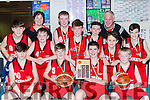 The Kenmare team celebrate winning u14 Division  in the Kery basketball finals in Killarney on Saturday front row l-r: Mark Torpey, Jimmy Lehane, Kevin O'Shea, Dylan Wallace. Aidan Crowley, Maureen O'Shea, Mark Casey, Hugh Granville, Aodan Macgearailt, Luke Scanlon, Johnny de Wouters and Calab Brosnan