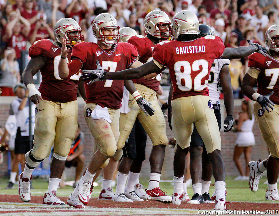 TALLAHASSEE, FL 9/25/10-FSU-WF FB10 CH-Florida State's Christian Ponder, left, and Willie Haulstead celebrate their second touchdown collaboration against Wake Forest during second half action Saturday at Doak Campbell Stadium in Tallahassee. The Seminoles beat the Demon Deacons 31-0..COLIN HACKLEY PHOTO