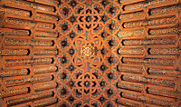 Painted coffered Mudejar ceiling, 16th century, in the Knights Room or Salon de Caballeros in the Madrasa of Granada, a mosque school founded 1349 by the Nasrid King Yusuf I, Sultan of Granada, in El Albayzin, the medieval Moorish old town of Granada, Andalusia, Southern Spain. This room served as a meeting place for the aldermen of the city after the reconquest. The madrasa functioned as a university until 1499 and is now part of the University of Granada. From the 8th to the 15th centuries, Granada was under muslim rule and retains a distinctive Moorish heritage. Granada was listed as a UNESCO World Heritage Site in 1984. Picture by Manuel Cohen