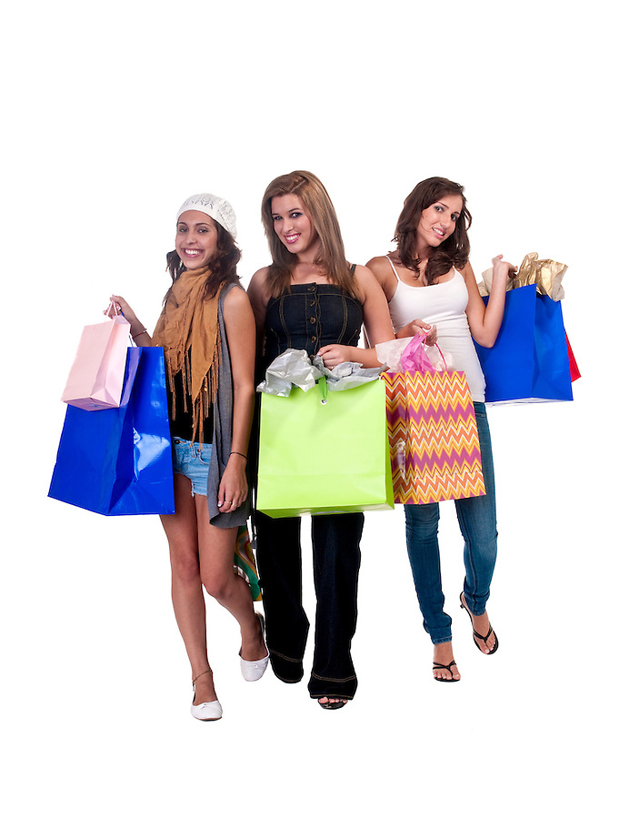 Group of multiracial girls, with shopping bags very cheerful and happy.