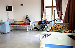 An elderly Palestinian woman prays at El Wafa elderly nursing home, in Gaza city on Feb. 12, 2017. El Wafa elderly nursing home was established in 1980 as one of programs of Al-Wafa charity association. El-Wafa hospital was destroy during the 50-day war between Israel and Hamas militants in the summer of 2014 by Israeli forces. Photo by Sana'a Al-Ajez