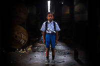 10 year old Mohamad Aji, second grade student at Kartini Emergency School, stands under the elevated highway where he lives in his makeshift home. Originally from.East Java, Aji's family came to the capital in search of a better life only to end up scavenging to make ends meet. &quot;When I grow up I want to become a policeman so I can arrest bad people,&quot; says Aji. Since the early 1990s, twin sisters Sri Rosyati (known as Rossy) and Sri Irianingsih (known as Rian) have used their family inheritance to set up and run 64 schools in different parts of Indonesia, providing primary education combined with practical skills to some of the country's most deprived children.