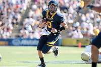 Beau Sweeney elects to run with the ball. The University of California Berkeley Golden Bears defeated the UC Davis Aggies 52-3 in their home opener at Memorial Stadium in Berkeley, California on September 4th, 2010.