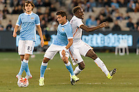 Melbourne, 21 July 2015 - Marcos Lopes of Manchester City and Mapou Yanga-Mbiwa of AS Roma fight for the ball in game two of the International Champions Cup match at the Melbourne Cricket Ground, Australia. City def Roma 5-4 in Penalties. (Photo Sydney Low / AsteriskImages.com)