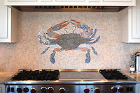 This custom kitchen features a handmade mosaic crab backsplash in Botticino, Blue Macauba, Celeste, Montevideo, Rosa Verona and Breccia Pernice from New Ravenna.<br />