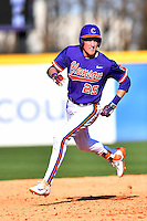 Third baseman Patrick Cromwell (25) of the Clemson Tigers rounds second after hitting a home run in the ninth inning in the Reedy River Rivalry game against the South Carolina Gamecocks  on Saturday, March 4, 2017, at Fluor Field at the West End in Greenville, South Carolina. Clemson won, 8-7. (Tom Priddy/Four Seam Images)