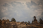 A firefigher walks a ridgeline on the Yarnell Hill Fire, July 3, 2013 in Yarnell, Arizona. Nineteen hot shots from nearby Prescott died in the fire on Sunday.