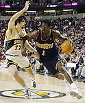 .Denver Nuggets Seattle Voshon Lenard drives against SuperSonics  Vladimir Radmanovic in the first half on Friday, March 21. 2003, at Key Arena in Seattle.  Jim Bryant Photo. &copy;2010. All Rights Reserved.