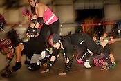 The Hellcats and Putas del Fuego, both of TXRD, or Texas Roller Derby, prepare for practice in Austin, Texas.