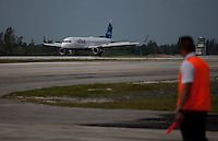 SANTA CLARA, CUBA - AUGUST 31 : Cuban worker looks at the first commercial flight between the US and Cuba during the arrival of  inaugural flight at Abel Santamaría Airport on August 31, 2016 in Santa Clara, Cuba. Photo by VIEWpress